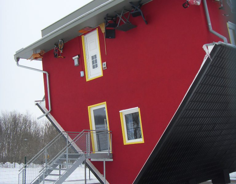 HOUSE STANDING ON ITS ROOF